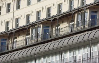 Stone cleansing, restoration, repairs, rendering and abrasive cleaning of Victorian Iron balconies.