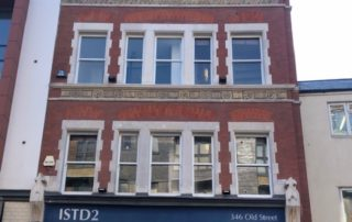 City of London. Cleaning of brick and stonework with ornate freesia bands After