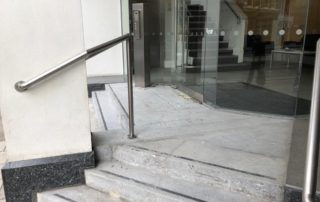 City of London: Remove existing front steps and install new stone tiles with steel beading edging.