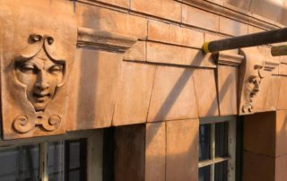 Kings cross London Cleaning of terracotta front facade with ornate gargoyle (after